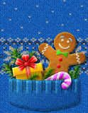 Gigngerbread man, gift, candy cane, branches in kn Stock Photos
