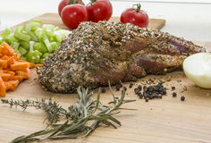 Gigot with vegetables and spices Stock Photography