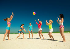 Giirls playing volleyball Royalty Free Stock Photo