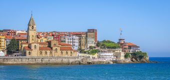 Panoramic view in Gijon with San Pedro Church, Asturias, northern Spain. Gijón is a large coastal city in northern Spain. It's known for its maritime Stock Image
