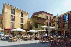 Gijón. GIJON, SPAIN - SEPTEMBER 8, 2012: A crowded street cafe customers in Gijon, Asturias, Spain, on September 8, 2013 Stock Image
