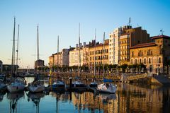 Gijon, Asturias, Spain; 09/26/2018: View of the dock of Gijon, Asturias, Spain, with reflections in the water, in Cimadevilla, the. Old town, during the sunset stock images