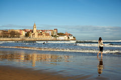 Gijon beach. Young woman walking at Gijon beach. travel destination in north of Spain, Europe Royalty Free Stock Image
