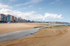 Gijon. Low Tide. Looking along the San Lorenzo beach towards the peninsula of Santa Catalina at Gijon in Asturias Royalty Free Stock Photos