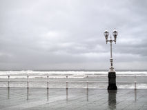 Gijon promenade with lamppost in rainy day Royalty Free Stock Images
