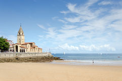Gijon, San Lorenzo Beach. Looking along the San Lorenzo beach towards the peninsula of Santa Catalina at Gijon in Asturias Royalty Free Stock Image