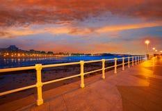 Gijon skyline sunset in San Lorenzo beach Asturias royalty free stock image
