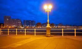 Gijon skyline sunset in San Lorenzo beach Asturias royalty free stock photos