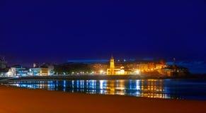 Gijon skyline sunset in San Lorenzo beach Asturias royalty free stock images