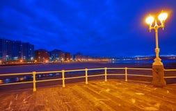 Gijon skyline sunset in San Lorenzo beach Asturias stock photos