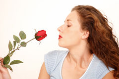 Gil with rose. Pretty girl smelling a rose, with copy space Stock Photos