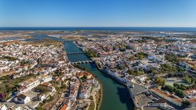 Gilao River and bridges in the city of Tavira. The Gilao River and bridges in the city of Tavira Royalty Free Stock Images