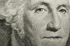 Gilberts Stuarts stående av den amerikanska grundläggaren, George Washington, från USA en dollarräkning arkivfoto