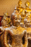 Gild ancient buddha statue in a Thai temple Stock Photo