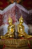 Gild Buddha Sculpture at Ancient Veranda of Wat Suthat, Bangkok of Thailand. Veranda of hundreds gild Buddha sculptures is a landmark of Wat Suthat is a great Stock Image