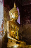 Gild Buddha Sculpture at Ancient Veranda of Wat Suthat, Bangkok of Thailand. Stock Photography