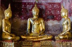 Gild Buddha Sculptures at Ancient Veranda of Wat Suthat, Bangkok of Thailand. Veranda of hundreds gild Buddha sculptures is a landmark of Wat Suthat is a great Royalty Free Stock Images