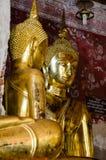 Gild Buddha Sculptures at Ancient Veranda of Wat Suthat, Bangkok of Thailand. Royalty Free Stock Photography