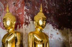 Gild Buddha Sculptures at Ancient Veranda of Wat Suthat, Bangkok of Thailand. Royalty Free Stock Images