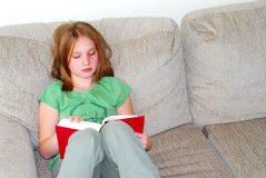 Gild child reading Royalty Free Stock Photo