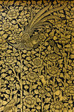 Gild Lacquer Art of Classic Thai Art Style. The gild lacquer work or in Thai name is Lai Rod Nam in classic Thai art style is a one of handicraft art work Stock Images