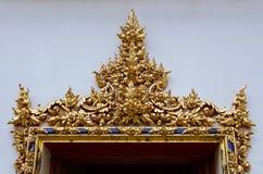 Gild Ornamental Door of Wat Pho Monastery at Bangkok. Gild ornamental door in floral detail is a unique decorative architecture of Wat Pho monastery at Bangkok royalty free stock images