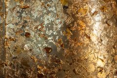 Gild texture background. Gold leaf on golden buddha statue stock photography