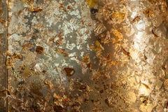 Gild texture background. Gold leaf on golden buddha statue stock image