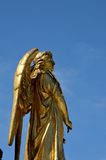 Gilded angel at base of Virgin Mary column outside Zagreb Cathedral Croatia. Zagreb, Croatia - March 29, 2015: A gilded angel with wings located at the base of Royalty Free Stock Images