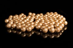 Gilded balls on a black background Stock Photos