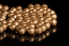 Gilded balls on a black background Royalty Free Stock Image