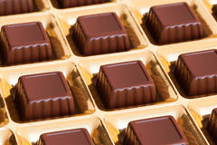 Gilded box of chocolates candy Stock Image