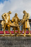 Gilded bronze statue of the Golden Boys, Birmingham, UK. Gilded bronze statue of Matthew Boulton, James Watt and William Murdoch by William Bloye and Raymond Royalty Free Stock Images