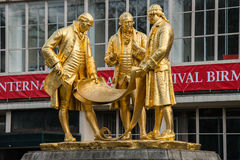 Gilded bronze statue of Matthew Boulton, James Watt and William. Murdoch by William Bloye and Raymond Forbes-Kings. Also known as the Golden Boys, or The Carpet Stock Photography