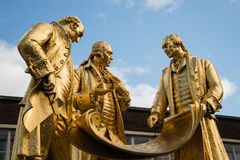 Gilded bronze statue of Matthew Boulton, James Watt and William. Murdoch by William Bloye and Raymond Forbes-Kings. Also known as the Golden Boys, or The Carpet Stock Photos