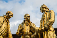 Gilded bronze statue of Matthew Boulton, James Watt and William. Murdoch by William Bloye and Raymond Forbes-Kings. Also known as the Golden Boys, or The Carpet Stock Images