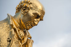 Gilded bronze statue of Matthew Boulton, James Watt and William. Murdoch by William Bloye and Raymond Forbes-Kings. Also known as the Golden Boys, or The Carpet Royalty Free Stock Images