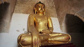 Gilded Buddha statue. Burma, Bagan stock footage