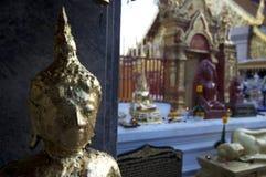 Gilded Buddha statue at Wat Doi Suthep royalty free stock photos