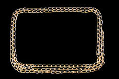 Gilded chainlet on a black background Stock Photography