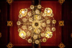 The gilded chandelier on the ceiling in a Buddhist Temple Stock Photography