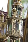 A gilded church lantern for a candle. Sacred service.  stock photo