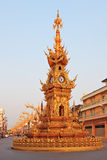 The gilded clock tower in the town square Stock Image