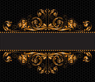 Gilded decor. Vintage gilded ornament on a black background Stock Photography