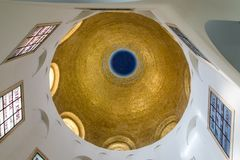 The gilded dome on the ceiling in the central hall of the Beatitude Monastery located on the mountain on the coast of the Sea of G stock photo