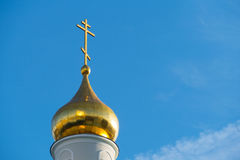 Gilded dome of the church against the blue sky. In Moscow on the street Dubininskaya royalty free stock image