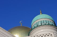 Gilded dome and crescent moon Muslim mosque stock image