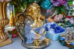 The gilded figure of an angel with wings stock images