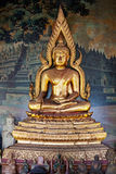 Gilded figure of Buddha in the temple. Indonesia Royalty Free Stock Images