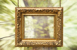 Gilded frame hanging with abstract background Stock Photos